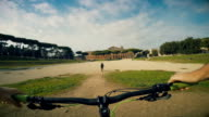 POV bicycle ride in the Circus Maximus of Rome