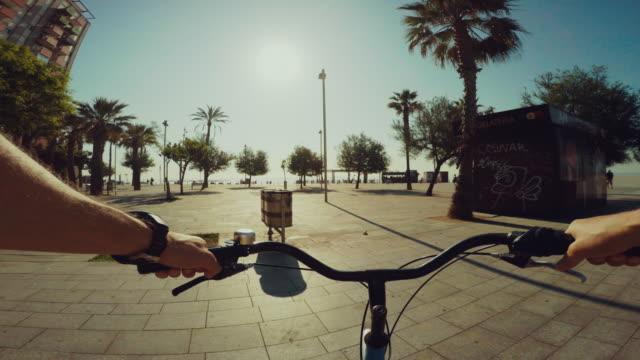 POV bicycle riding in Barcelona summer vacations
