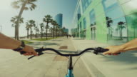 POV bicycle riding in coastal resort summer vacations