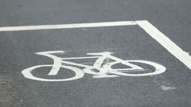 WS Bicycle symbol on asphalt in Victoria Embankment / London, England, United Kingdom