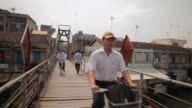 WS Bicyclist and People Walking down Wooden Bridge / Vietnam