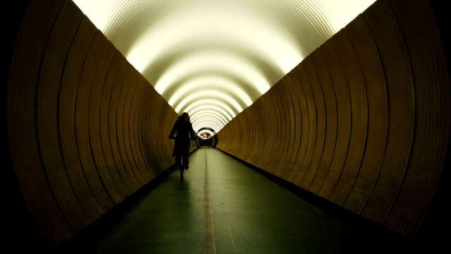 Bicyclist in yellow tunnel