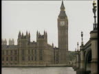 Big Ben and Houses of Parliament across River Thames zoom in to House of Commons windows