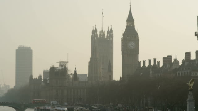 Big Ben and part of Westminster bridge with bus passing by.