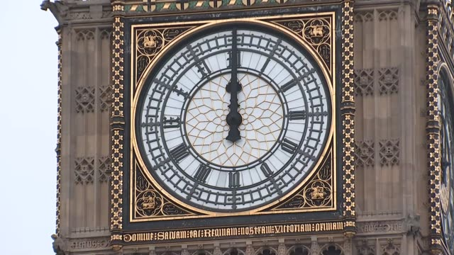 Big Ben chimes / Parliament Square general views ENGLAND London Westminster EXT Close up shot of Big Ben / Big Ben chiming at 12 o'clock SOT /...