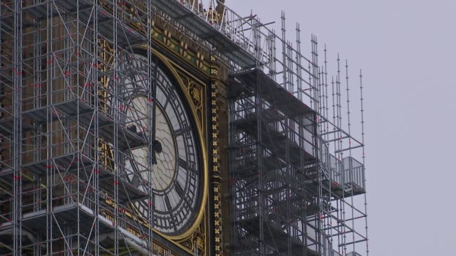 Big Ben chimes reconnected for Armistice day ENGLAND London Westminster EXT Big Ben clock face with scaffolding around for rennovations as chimes...