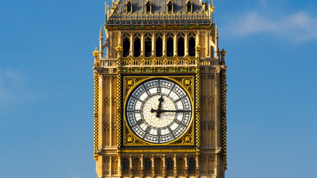T/L Big Ben clock hands moving from 12 o'clock to 1, with clouds, London, England