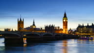 Big Ben, Houses of Parliament and Westminster Bridge, day to night time lapse. London, England