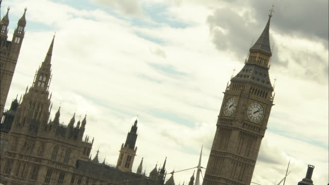 Big Ben keeps time near the Houses of Parliament in London.