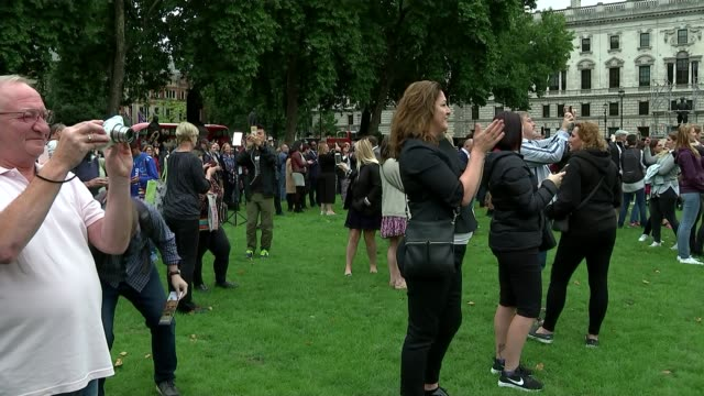 Bells go silent for four years ENGLAND London Westminster Parliament Square EXT Various of crowd applausing as bell sounds for final time before...