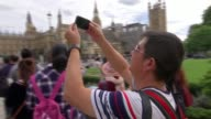 Theresa May says it simply 'cannot be right' to silence the bongs for four years ENGLAND London Westminster EXT Couple posing for selfie photo in...