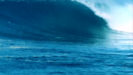 Big blue 20ft wave barreling down reef in remote Indonesia.