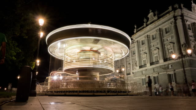big carousell in palacio real madrid timelapse at night