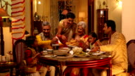 Big family eating dinner, Delhi, India