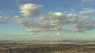 WS AERIAL Big open sky with pretty clouds and sprawl in Phoenix Basin / Phoenix, Arizona, United States