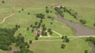 WS AERIAL DS ZI Big Ranch with portico surrounded by tree / Oklahoma, United States