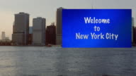 Big sign beautiful boat dragging big welcome sign NYC