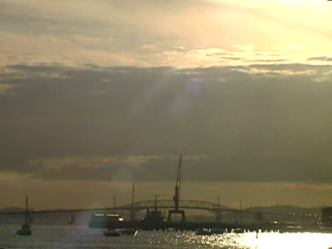Big Sunset, Sunrise Sky over Silhouetted Bridge and Port, Pull