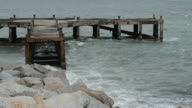 Big wave and old pier