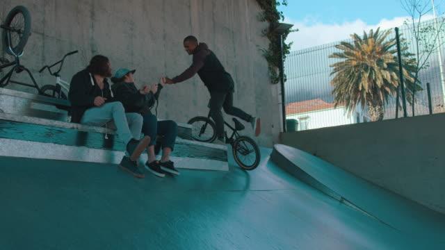 BMX biker driving through stunt park