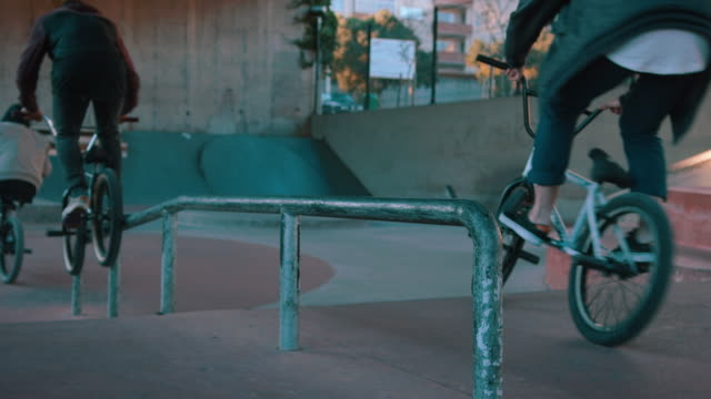 BMX biker grinding on rail
