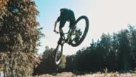 SLO MO MTB biker jumping over the camera