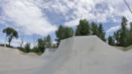 A BMX biker jumps off of a feature at a skate park in Idaho