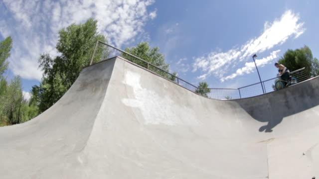 A BMX biker rides around a skate park in Idaho