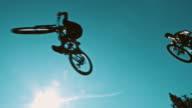 SLO MO MTB bikers jumping over the camera