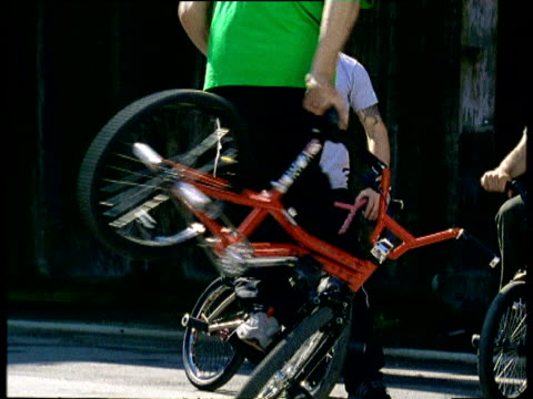BMX bikers perform tricks and stunts including spins using stunt bolts Oberhausen Germany