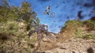 SLO MO MTB bikers riding on a downhill trail