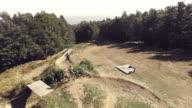 AERIAL MTB bikers speeding on a downhill trail