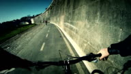 Biking on bicycle lane by the Tiber River in Rome