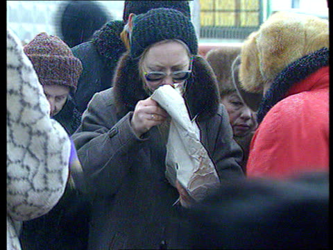 Bill Clinton meets Boris Yeltsin in Moscow EXT Women crowding around on streetsgetting things out of box CMS People putting goods into bags LAGV...
