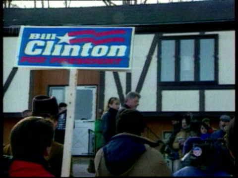 Bill Clinton speaks to crowd during presidential campaign / supporters with signs / he says 'This country is in trouble / We are in recession due to...