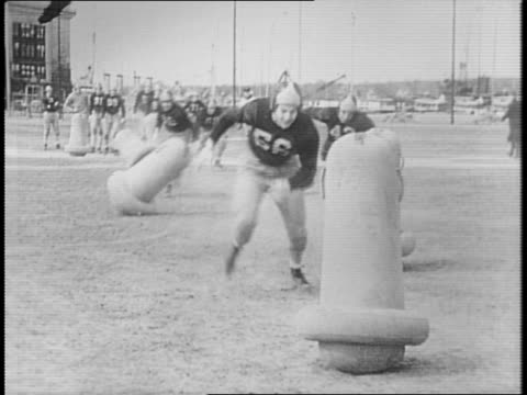 Bill Slater speaking into a microphone superimposed over football players running / Annapolis Navy Midshipmen football team running on dock / players...