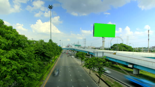 Billboard and highway with moving cloud ,time lapse