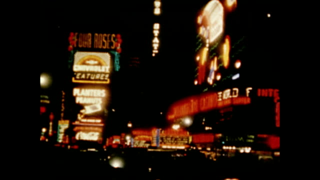 / billboards and marquees in Times Square at night / Radio City Music Hall exterior / neon signs Times Square Lights at Night on January 01 1971 in...