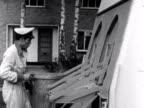 Bin men empty bins into a new dust cart