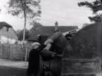 Bin men empty bins into an old dust cart