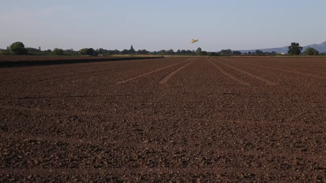 A biplane from Williams Ag Service drops rice seeds on a field on May 8 2015 in Biggs California As California enters its fourth year of severe...