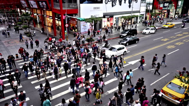 Bird view of the pedestrians go crossing the street in downtown, Taiwan, China