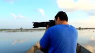 Bird watcher auf dem Boot