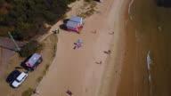 Bird's eye view of Brighton beach, colourful bathing houses