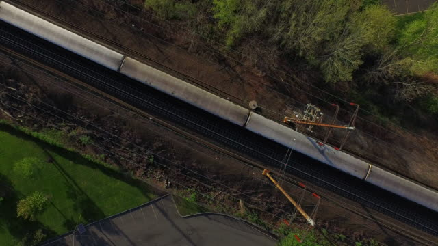 Bird's eye view of train running diagonally from right to left of frame