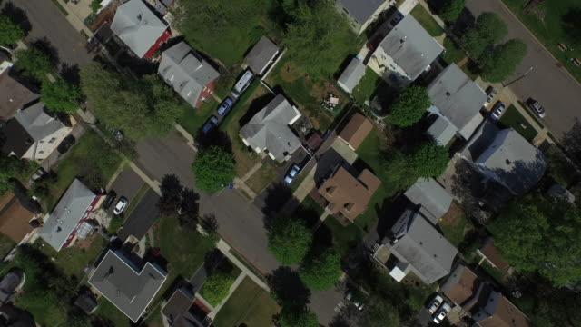 Bird's eye view panning left over New Jersey suburb