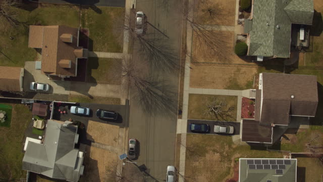 Bird's eye view panning over suburban homes in New Jersey