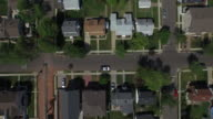 Bird's eye view panning to the right over single family homes in a New Jersey suburb