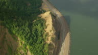 AERIAL birds eye view track along highway next to Columbia River / Oregon, United States
