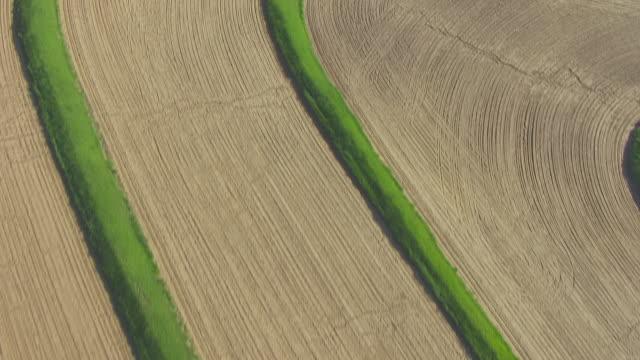 WS AERIAL Birds Eye View track over terraced fields / Nebraska, United States
